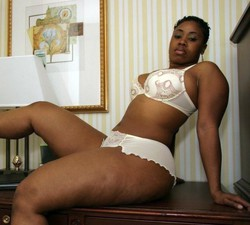 Fatty black wife posing in tight white..