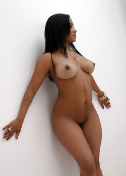 Tender ebony beauty sitting naked and..