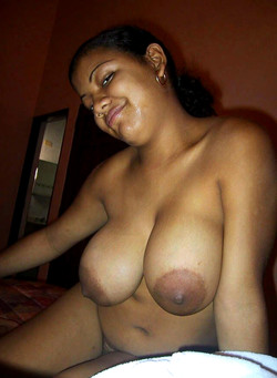 Ebony cutie with big tits self-shooting