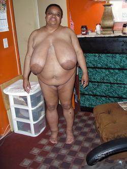 Very fat black mature woman sitting..