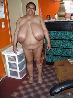 Very fat black mature woman sitting..